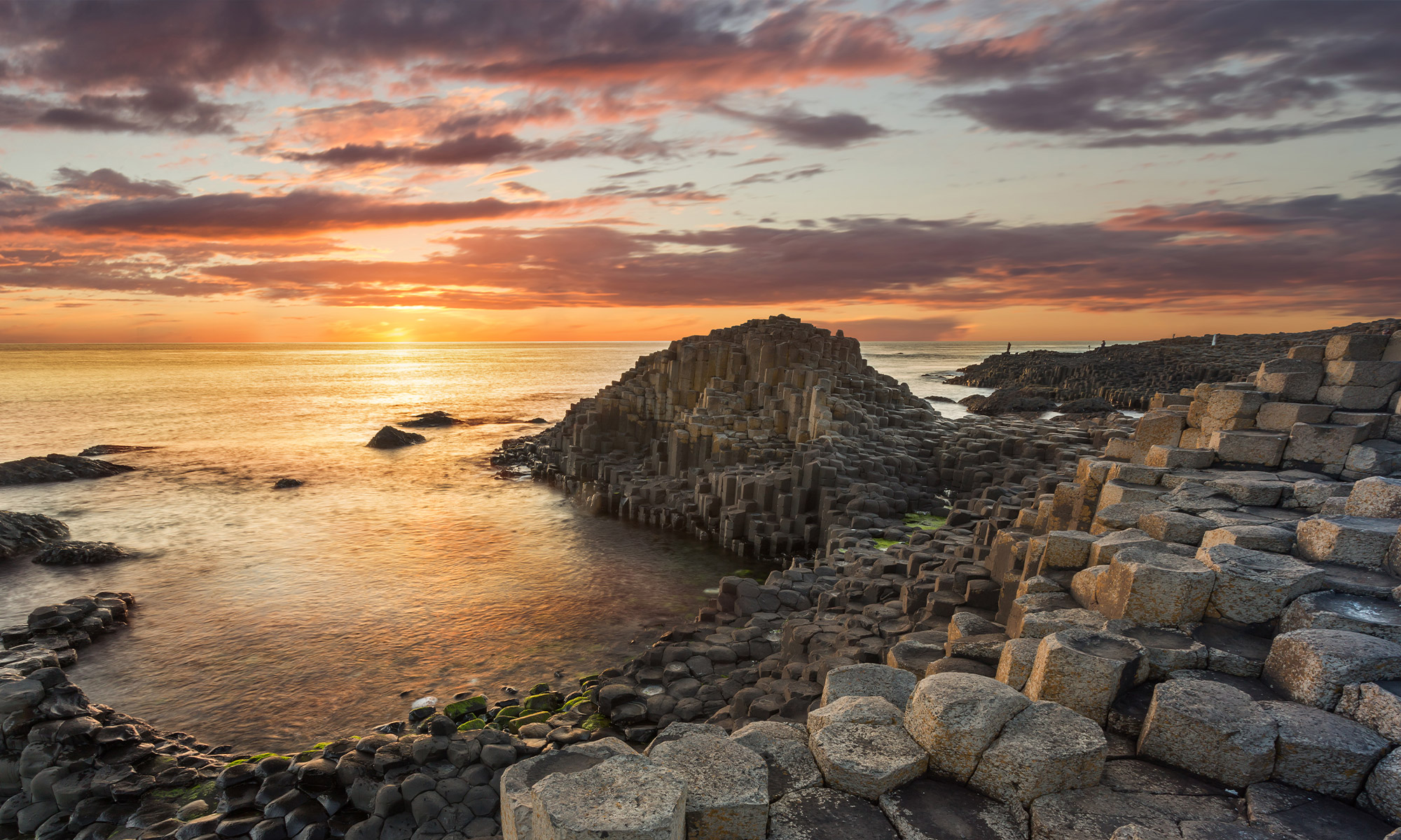 The Giant's Causeway bathed with evening sunset
