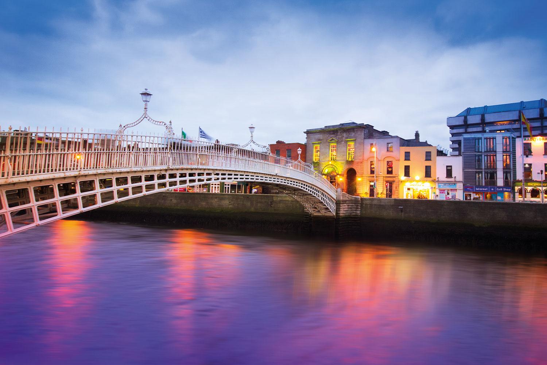 Ha' Penny Bridge over River Liffey in Dublin, Ireland